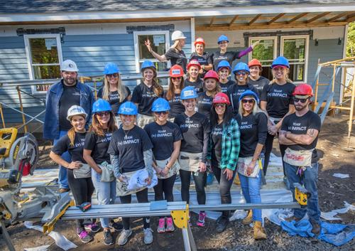 ALEX AND ANI's Team (+) Impact Volunteers with Habitat for Humanity