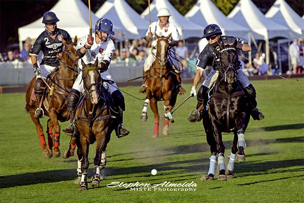 Four players charging the camera at the Newport International Polo Series Finals on Sept. 26, 2020
