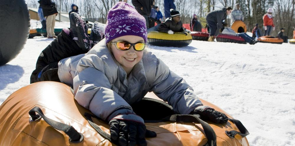 Snowtubing Little Girl